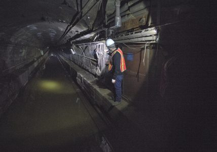 A Metropolitan Transportation Authority employee inspects flooding in the L train tunnel under the East River in New York City. The tunnel was flooded during the unprecedented 13-foot storm surge of Hurricane Sandy. (Photo: MTA of New York)