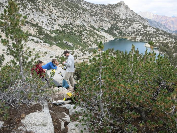 From left, Aaron Putnam, Adam Hudson and Ben Hatchett calculate the exact position of a boulder they've sampled above Baboon Lakes in the Sierras of central California. All photos: David Funkhouser