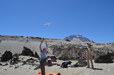 Elise Rumpf launches a small drone with a camera over Chile's Quizapu volcano. (Lamont-Doherty Earth Observatory)