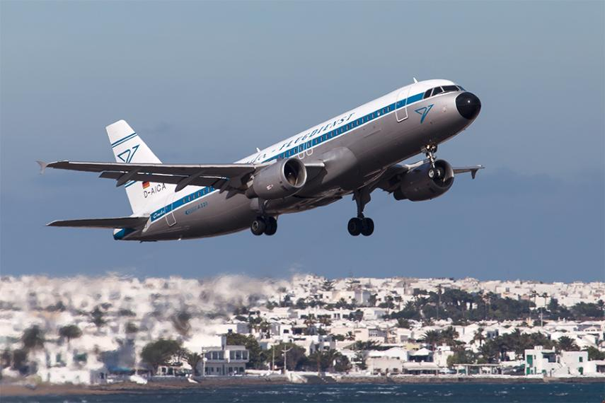 Due to warming climate, some aircraft may soon have a hard time getting off the ground in the heat of the day. Here, a jet takes off from the Canary Islands. (Bruno Gelger, via flickr)