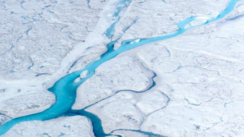 Rivers of meltwater flow across the Greenland ice sheet. (Photo courtesy of Marco Tedesco/Columbia University)