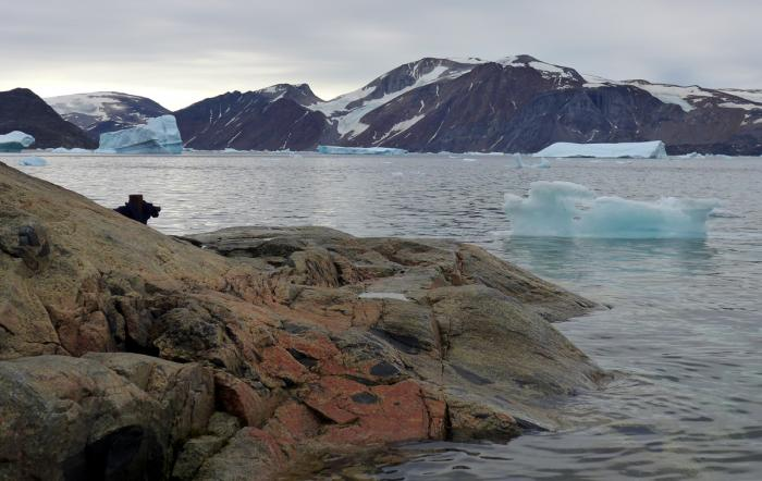 Bedrock drilled from deep under the Greenland ice sheet contains evidence that the island was nearly denuded of ice for an extended time during the last million years.  Here, icebergs discharged from Allison Glacier float near Kullorsuaq, western Greenland. Photo: Margie Turrin/Lamont-Doherty Earth Observatory