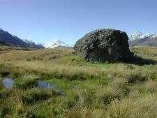 Erratic Boulder with Mt. Cook in the background, New Zealand's Southern Alps