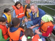 students sampling at the river