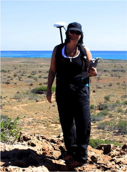 Maureen Raymo carries GPS equipment for marking ancient shorelines.