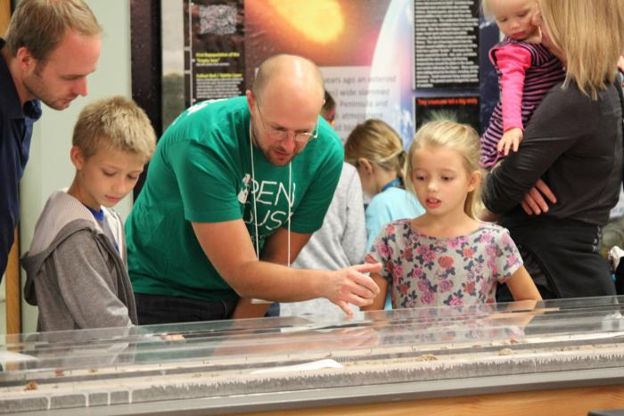 The Lamont Core Lab was another favorite, with visitors lined up out the door. Billy D'Andrea shows young guests how scientists use deep-sea sediment cores to learn about climates in the past.