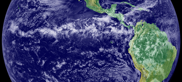 The Intertropical Convergence Zone (ITCZ) appears in this satellite image as the band of clouds circling the Earth near the equator. The image is a combination of cloud data from NOAA's Geostationary Operational Environmental Satellite (GOES-11) and color land cover classification data. Credit: NOAA-NASA GOES Project