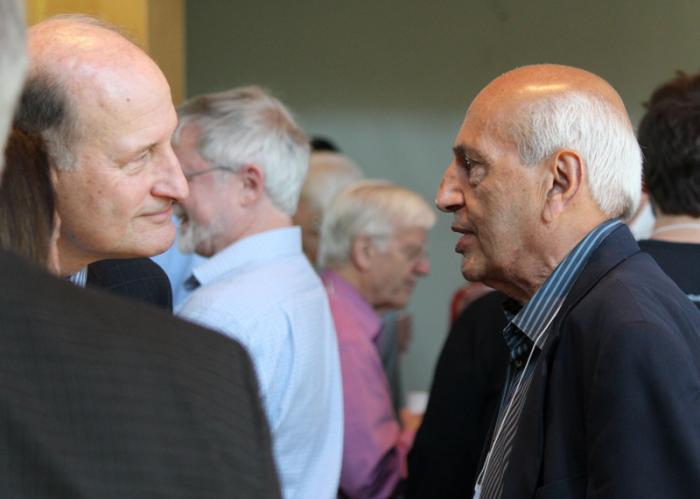 Former Lamont Director Manik Talwani, right, speaks with geologist Roger Buck during a break at the symposium.
