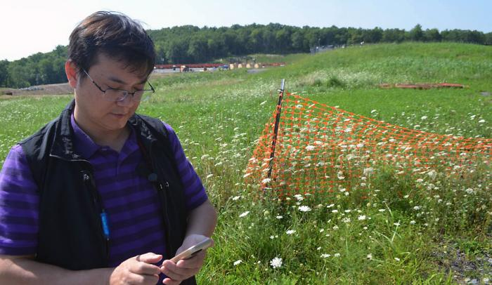 A study conducted in northeastern Pennsylvania suggests that drinking water near hydraulic fracturing sites is undergoing chemical changes. Lead author Beizhan Yan looks at a site on a back road. Photo: Kevin Krajick/Lamont-Doherty Earth Observatory