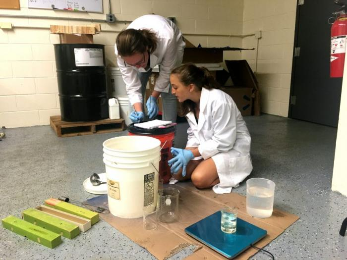 High school intern Julia Grandury (right) works with Elizabeth Eiden (left), an undergraduate intern from the California Institute of Technology. The two students are spending the summer conducting research on lava lakes and open-vent volcanoes in the lab of Lamont scientist Einat Lev
