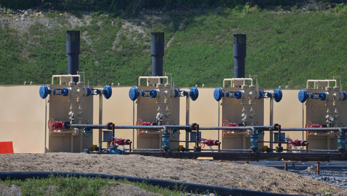 Tanks await use at a newly drilled hydraulic fracturing site. Photo: Kevin Krajick
