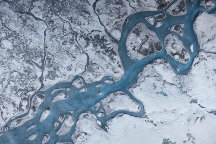 "Greenland's ice can ""darken"" in ways we can see and ways we can't. Photo: Marco Tedesco"