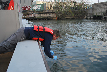 Newtown Creek on the border of Brooklyn and Queens consistently shows high counts of sewage-indicator bacteria, and now, those resistant to antibiotics. Andrew Juhl collects samples after Hurricane Sandy. (Kim Martineau)