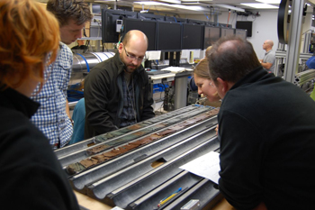 cientists take a first look at a freshly-split sediment core covering the last 50 million years.