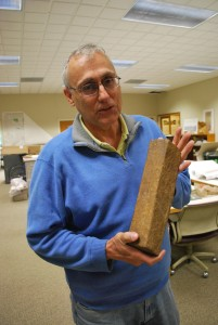 As magma solidifies, it forms cylindrical columns as shown in this sample displayed by geologist Mark Anders. (Kim Martineau)