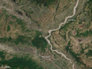 Two weeks after the landslide, the Seti River appears wider than usual and choked with grayish silt. (NASA)