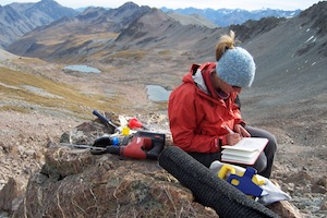 Samples of glacial debris, like this boulder, lets researchers retrace the path of ancient glaciers. Credit: Mike Kaplan. (Alice Doughty, University of Maine pictured)