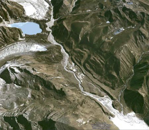 The Raphstreng/Bechung glaciers, seen here in a satellite image, feed rivers below—and a growing meltwater lake (blue) held back only by a rubbly dam that threatens to burst.  (Google Earth)