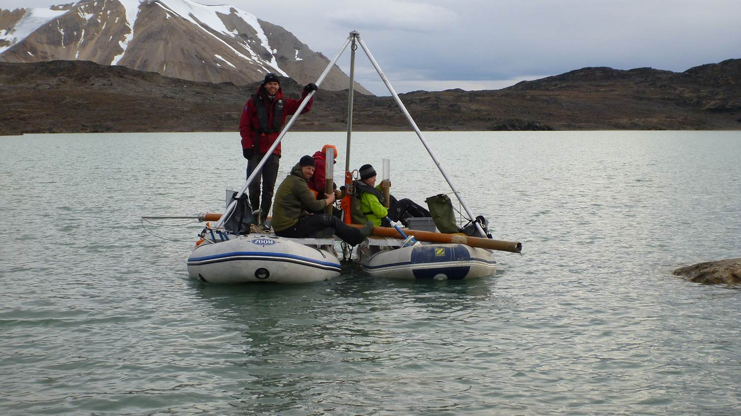 With a basic coring rig and two inflatable rafts lashed together to form a platform, scientists on Svalbard can extract sediments from the lakebed below
