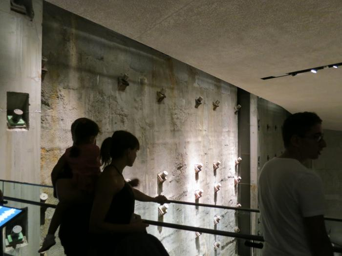 Visitors to the underground September 11 Museum view part of the massive retaining wall that surrounded the towers' foundations. Seismic waves from the plane impacts and tower collapses first passed through this wall and into the earth's crust. Photo: Kevin Krajick